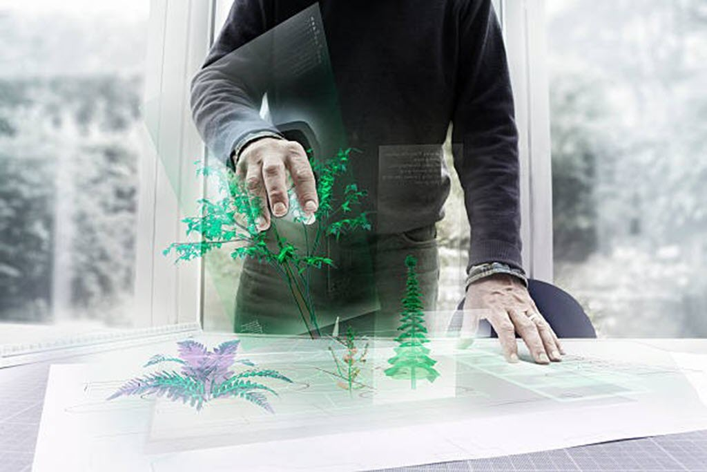man growing augmented reality flowers